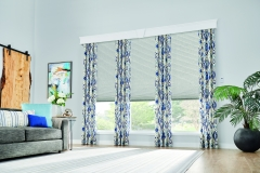 """Windows: 3/4"""" Single Cell Cellular Shades with Motorized Lift: Couture, Noble Pewter 0133 and 7 1/2"""" Noble  Cornice with Keystone: Snowflake 1603 Drapery: Decorative Panels with Grommet Top: Kearney, Lakeshore 5760"""