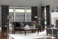 Custom-draperies-on-decorative-rod-layered-over-top-down-bottom-up-cellular-shades