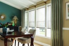 custom-draperies-on-decorative-rod-over-solar-shades