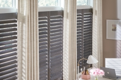 custom-pinch-pleat-draperies-on-a-decorative-rod-layered-over-shutters
