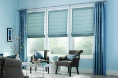 custom-pinch-pleat-draperies-over-front-fold-roman-shades