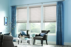 custom-pinch-pleat-draperies-over-wood-blinds-and-attached-wood-valance