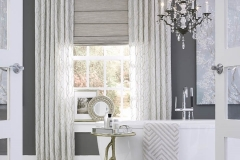 front-fold-roman-shades-with-pinch-pleat-decorative-rods-layered-overtop-in-bathroom